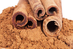Cinnamon sticks and powder isolated on white background Royalty Free Stock Photos