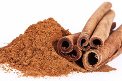 Cinnamon sticks and powder isolated on white background Stock Photo