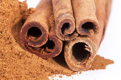 Cinnamon sticks and powder isolated on white background Royalty Free Stock Images