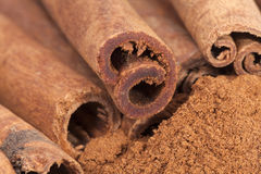 Cinnamon sticks and powder isolated on white background Stock Images