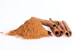 Cinnamon sticks and powder isolated on white background Royalty Free Stock Photo
