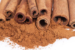 Cinnamon sticks and powder isolated on white background Stock Photos
