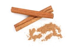 Cinnamon sticks with powder isolated on white background. Top view.  royalty free stock image
