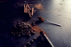 Cinnamon sticks powder in spoons coffee beans.  stock image