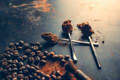 Cinnamon sticks powder in spoons coffee beans royalty free stock photo