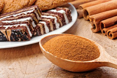 Cinnamon sticks and powder with sweets Stock Photo