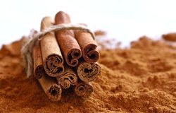 Cinnamon sticks and powder on table Stock Photography