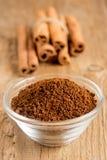 Cinnamon sticks and powder Royalty Free Stock Photos