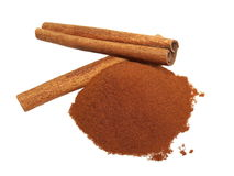 Cinnamon sticks with powder on white Royalty Free Stock Images
