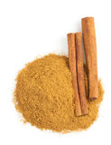 Cinnamon sticks and powder on white Stock Photography