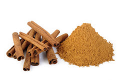 Cinnamon sticks and powder at on white background Stock Photography