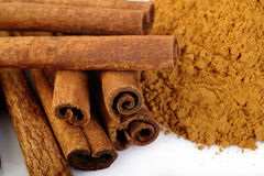 Cinnamon sticks and powder at on white background Royalty Free Stock Photography