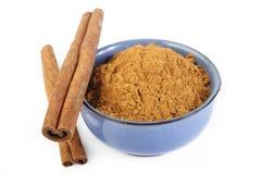 Cinnamon sticks and powder at on white background Stock Photos