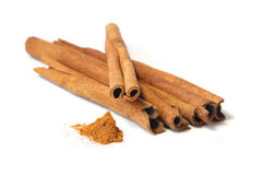 Cinnamon sticks and powder. Royalty Free Stock Photos
