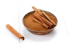 Cinnamon sticks and powder on white stock image