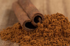 Cinnamon sticks with powder Stock Photo