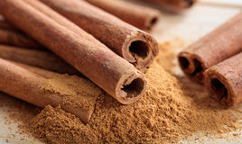 Cinnamon sticks and powder. On a wooden surface Stock Photography