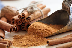 Cinnamon sticks and powder. On a wooden surface Stock Photos
