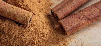 Cinnamon sticks and powder. On a wooden surface Royalty Free Stock Photos