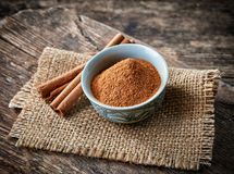 Cinnamon sticks and powder Royalty Free Stock Image