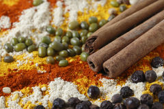 Cinnamon sticks with pulses and spices Royalty Free Stock Photo