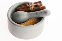 Cinnamon sticks with pure cane brown sugar in mortar Royalty Free Stock Photography