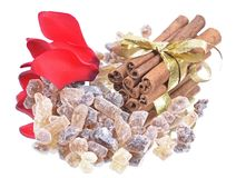 Cinnamon sticks with pure cane brown sugar on whit Royalty Free Stock Image