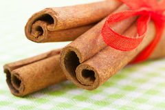 Cinnamon sticks with red ribbon close up Stock Image