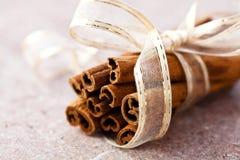 Cinnamon sticks with ribbon Stock Photography