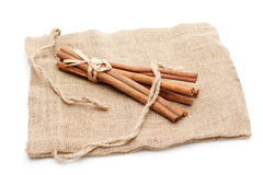 Cinnamon sticks on sack Stock Photos