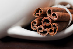 Cinnamon sticks, shot close-up on the table. Royalty Free Stock Photo
