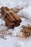 Cinnamon sticks,snowflake and marshmallows for christmas Royalty Free Stock Photo