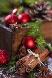 Cinnamon sticks. Some christmas baubles with cinnamon sticks and anise stars Stock Photos