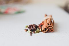 Cinnamon sticks and spices. On the kitchen table Royalty Free Stock Photography