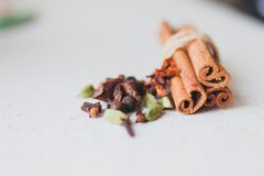 Cinnamon sticks and spices. On the kitchen table Royalty Free Stock Image