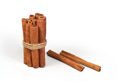 Cinnamon sticks (spices). Cinnamon sticks tied with a rope on a white background Stock Images