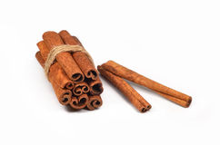Cinnamon sticks (spices). Cinnamon sticks tied with a rope on a white background Stock Photography