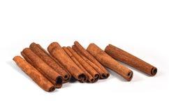 Cinnamon sticks (spices). On white background Stock Photos
