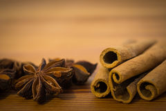 Cinnamon sticks and spicy star anise seeds on the wooden table.  stock image