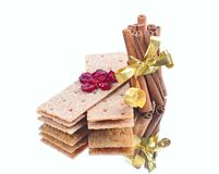 Cinnamon sticks ,stack of crispbread on white back Stock Images