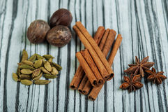 Cinnamon sticks, star anise, cardamom and nutmeg Royalty Free Stock Photography