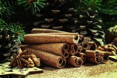 Cinnamon sticks and star anise in the Christmas decoration with royalty free stock image