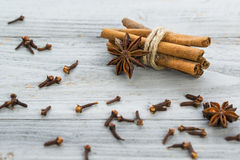Cinnamon sticks, star anise and cloves. On a grey wooden background Royalty Free Stock Photography