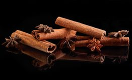 Cinnamon sticks and star anise isolated on black stock image