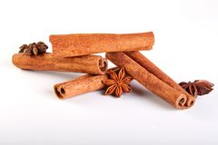Cinnamon sticks and star anise  on white royalty free stock image