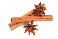 Cinnamon sticks and star anise isolated on white background. Top view.  royalty free stock image