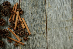 Cinnamon sticks, star anise and pine cones Royalty Free Stock Photography