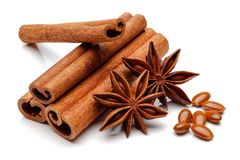 Cinnamon sticks and star anise with seeds isolated. On white background stock photos