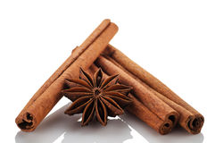 Cinnamon sticks and star anise on a white background royalty free stock photo