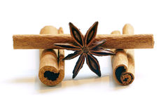 Cinnamon sticks and star anise,  on white Stock Photos
